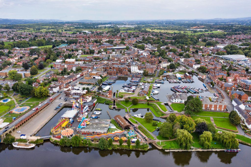 An image of Stourport Town, Stourport-on-Severn, from the air. Including The high street, river sever, tontine, Stourport Canal Basins, Treasure Island Amusements and more. Image credit Michael Whitefoot